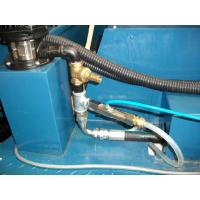 Wogaards udstyr til genanvendelse af kølevæske til maskine installeret på en CNC-maskine.