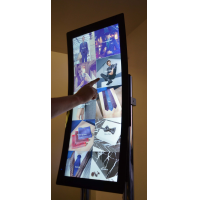 A curved touch screen using a custom size touch screen overlay