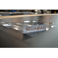 A large format touch screen display touch foil