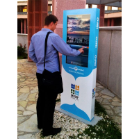 A man using an outdoor touch screen totem
