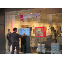 A touch screen through a shop window thanks to VisualPlanet, leading PCAP touch screen manufacturers.