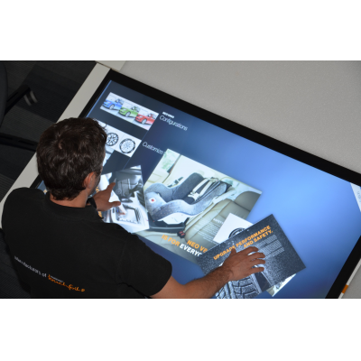 A man using a dust proof touch screen table