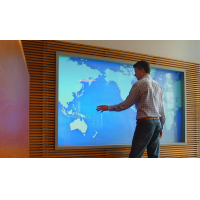 A man using a large PCAP screen from VisualPlanet, touch screen manufacturers