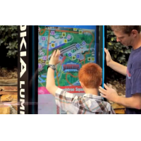A VisualPlanet outdoor touch screen kiosk being used by a father and son