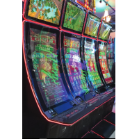 A curved gaming machine from VisualPlanet, touch screen foil manufacturers