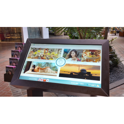 A self service touch screen kiosk with a PCAP foil