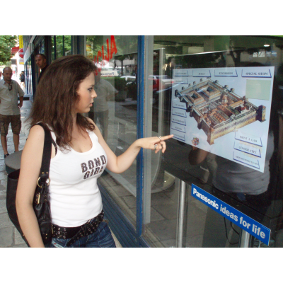 Girl using touch screen with interactive foil
