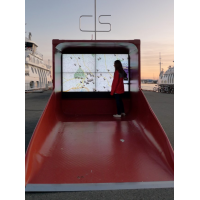 A woman using a PCAP interactive wayfinding kiosk