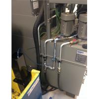 Machine coolant recycling equipment on a CNC machine.