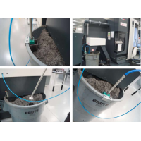 Machine coolant recycling equipment from Wogaard installed on a CNC machine.