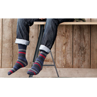 A man wearing striped socks from the leading quality sock supplier.