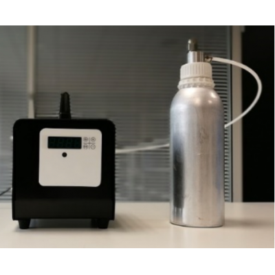 Aromatise industrial air freshener with scent bottle.
