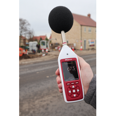 An Optimus+ decibel meter being used for environmental noise measurement.