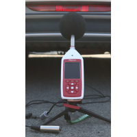 Bluetooth decibel meter measuring vehicle noise.