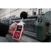 Nosie level meter being used to measure industrial noise.