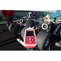 Bluetooth sound level meter being used for engine noise measurement.
