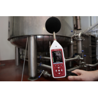 Occupational noise exposure monitor in use in an industrial workplace.