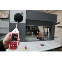 Occupational noise exposure monitor being used in a factory.