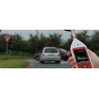 An Optimus decibel meter being used for environmental noise measurement.