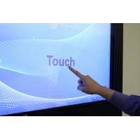 Digital signage touch screen close up being used
