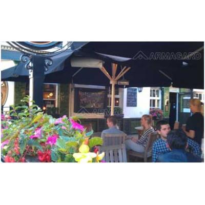 Waterproof outdoor LCD TV enclosure in a pub garden