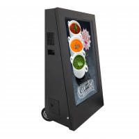 The pavement digital signage unit uses a 43-inch screen to attract customers.