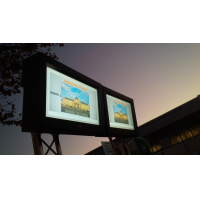 Outdoor digital signage enclosures in situ outside