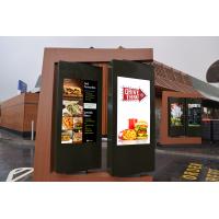 Drive thru kiosk manufacturer menu boards in use at a fast food restaurant.