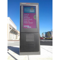 Anti-glare totem digital signage in-situ on a street