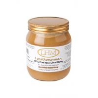 Tarro de miel sin procesar de oro puro