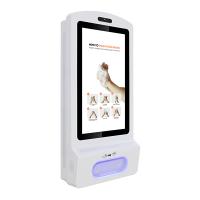 Display digitale disinfettante per le mani con vista frontale rivolta a destra.